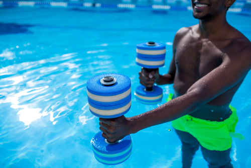 water workout, water aerobics, man working out in pool, low impact exercise